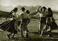 Goral men & women dancing in costume